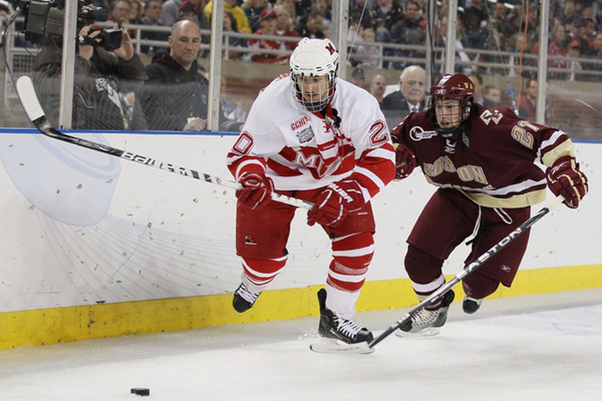Pat Cannone #20 of the Miami Redhawks and Patch Alber #27 of the Boston College Eagles chase after the puck on April 8, 2010 during the semifinals of the 2010 NCAA Frozen Four at Ford Field in Detroit, Michigan.  (Photo by Elsa/Getty Images)