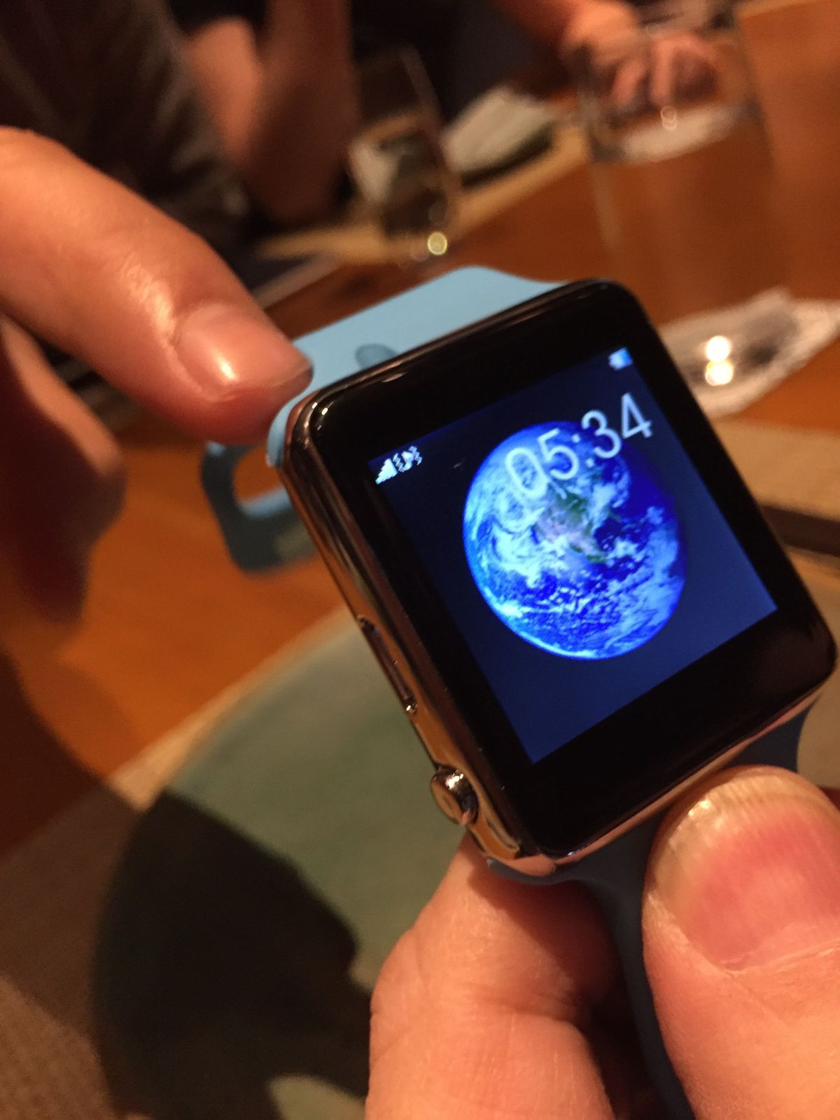 The fake watch uses a familiar Apple image on one screen.