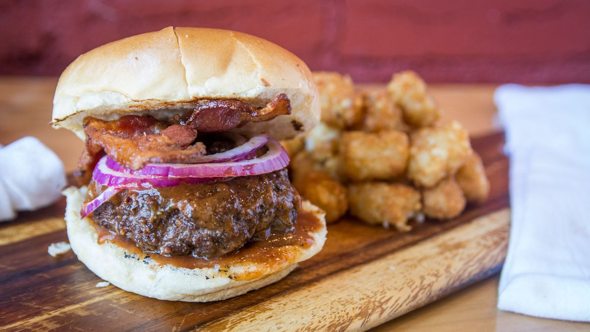 BBQ Bus's new Brookland location has a to-go bacon burger with tots.