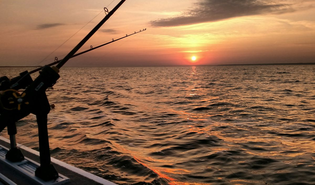Dawn over Green Bay at the start to muskie fishing.<br>Credit: Dale Bowman