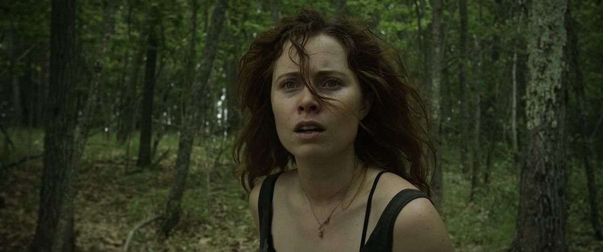 Hannah Emily Anderson looks scared in the woods