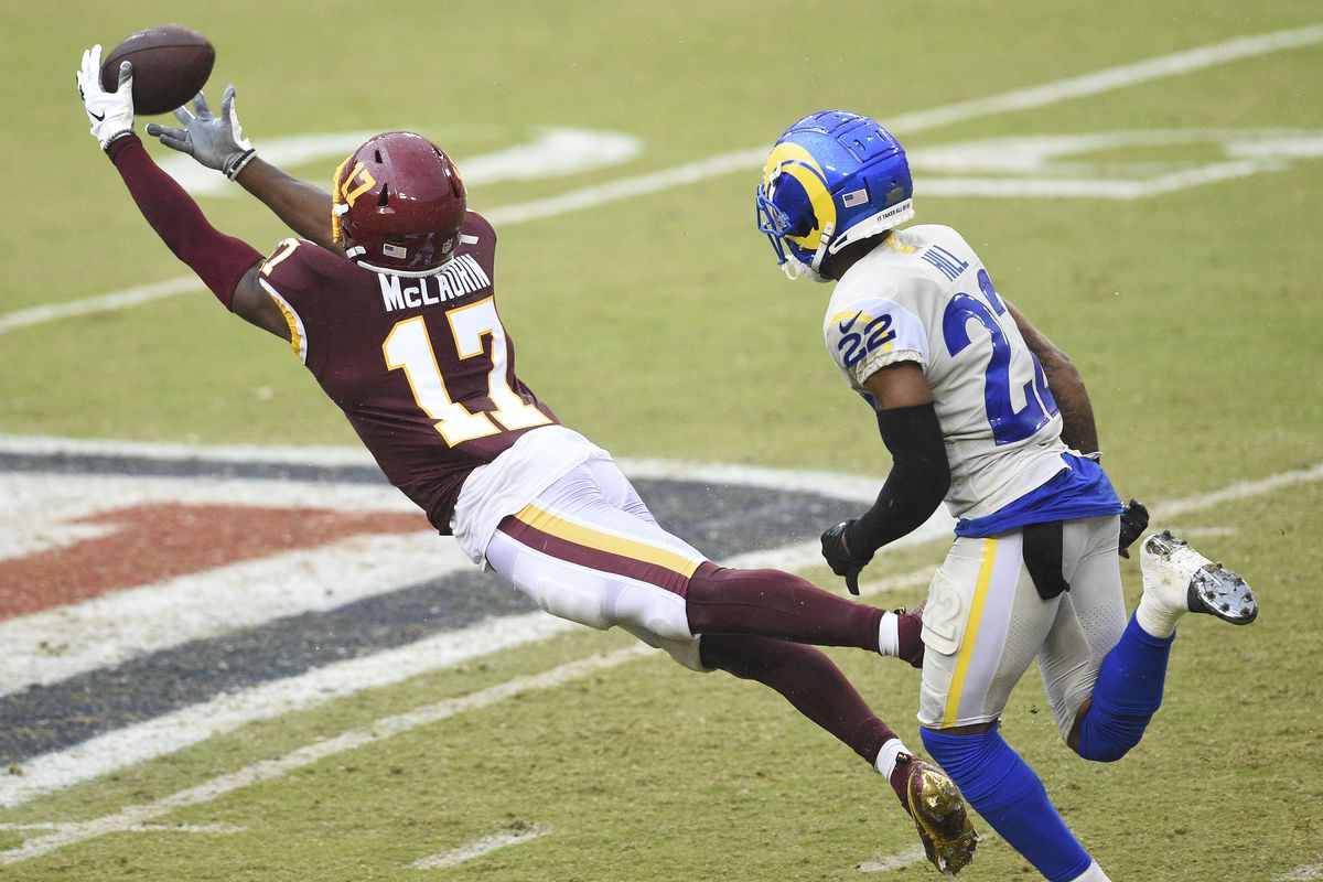 Terry McLaurin #17 of the Washington Football Team is unable to catch a pass as he defended by Troy Hill #22 of the Los Angeles Rams in the second half at FedExField on October 11, 2020 in Landover, Maryland.