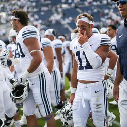 Brigham Young Cougars defensive back Austin Lee (11) and other players leave the field after losing 40-6 to the Wisconsin Badgers at LaVell Edwards Stadium in Provo on Saturday, Sept. 16, 2017.