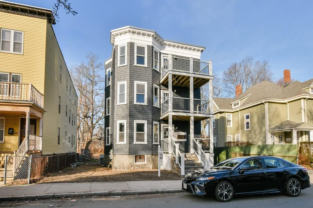 The exterior of a three-story house with porches off each floor.