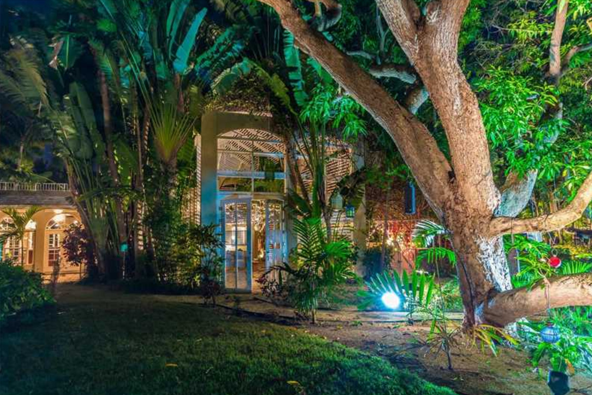 A charming vintage home in Miami Beach with lush landscaping and a ton of canal frontage