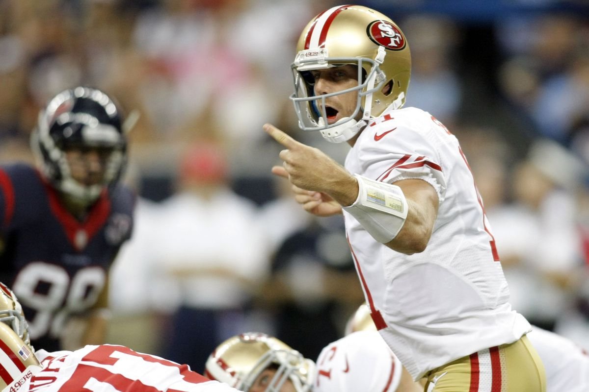 Aug 18, 2012; Houston, TX, USA; San Francisco 49ers quarterback Alex Smith (11) calls a play at the line against the Houston Texans in the first quarter at Reliant Stadium. Mandatory Credit: Brett Davis-US PRESSWIRE