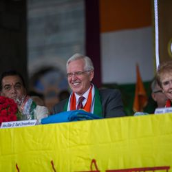 Elder D. Todd Christofferson, a member of the Quorum of Twelve Apostles for The Church of Jesus Christ of Latter-day Saints, center, joined by his wife, Sister Kathy Christofferson, reacts during the 71st Independence Day celebrations at the MIT World Peace University in Pune, Maharashtra, India, on August 15, 2017.