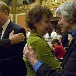 Rep. Kevin Garn, left, is consoled Thursday after confessing to a nude hot-tubbing incident. His wife, Tanya Garn, is hugged by Pamela Atkinson, right.