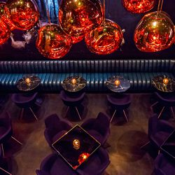 A look down from the second floor at Himitsu, showing off the chandeliers.