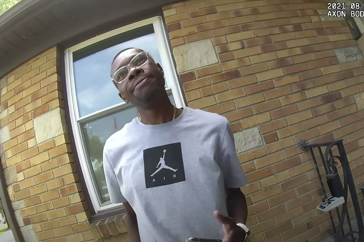 This image from video provided by the Wyoming, Mich., police department shows real estate agent Eric Brown outside a home he was showing to a potential buyer in Wyoming, Mich. Police handcuffed Brown, his client and that man's 15-year-old son after a neighbor wrongly reported the three Black people were breaking into a home.