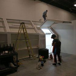 Members of Women's Ski Jumping USA team use a 100-foot-long wind tunnel built by Layne Christensen, founder of Darko Technologies, in Ogden's Business Depot on Thursday, Sept. 26, 2013.