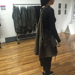 Serius sweater, worn with backpack straps, $199 (originally $401)