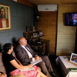 A man in Uruguay watches a session of The Church of Jesus Christ of Latter-day Saints' 191st Annual General Conference, which was broadcast from Salt Lake City on Saturday, April 3, and Sunday, April 4, 2021.