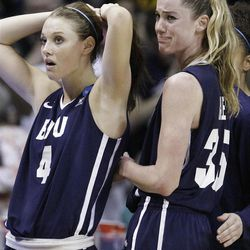 BYU guard Kim Parker (left) and forward Kristen Riley react to their team's 59-55 loss to DePaul.