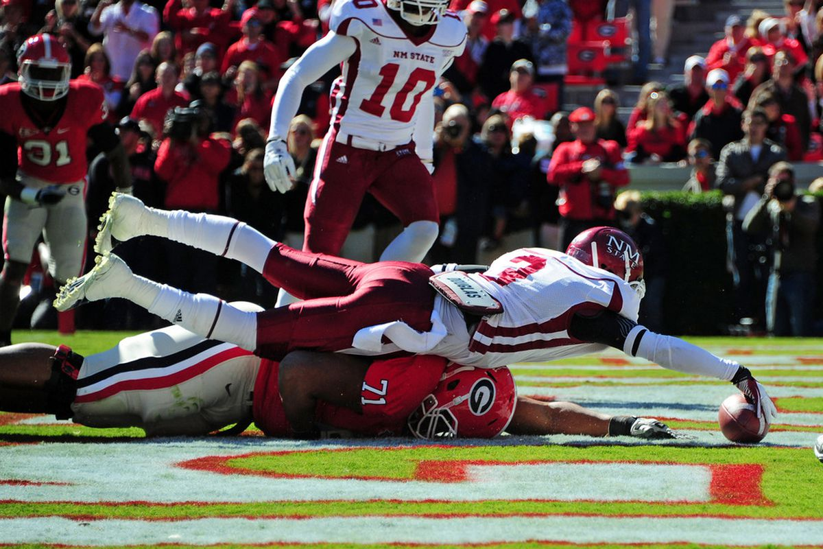 ATHENS, GA - NOVEMBER 5: Donyae Coleman #3 of the New Mexico State Aggies recovers a fumble over Cordy Glenn #71 of the Georgia Bulldogs at Sanford Stadium on November 5, 2011 in Athens, Georgia. Photo by Scott Cunningham/Getty Images)