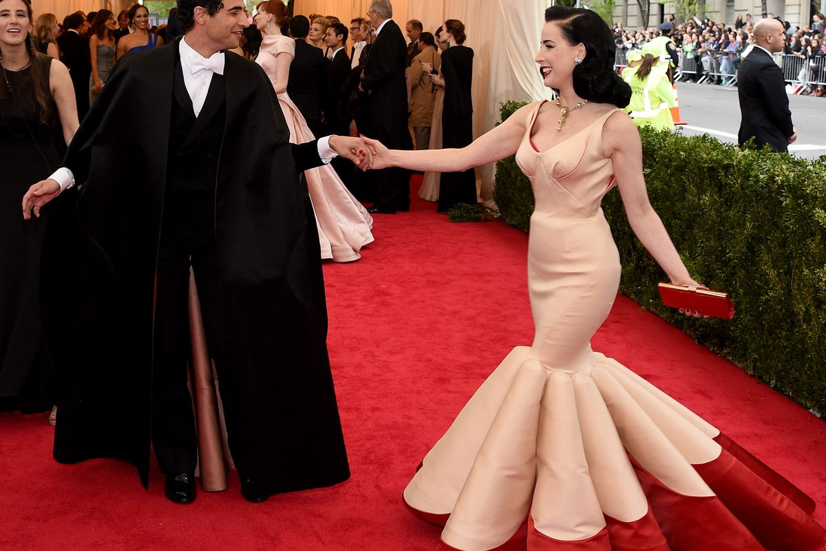 Posen with Dita von Teese, in a dress of his design, at the 2014 Met Ball. Photo: Getty