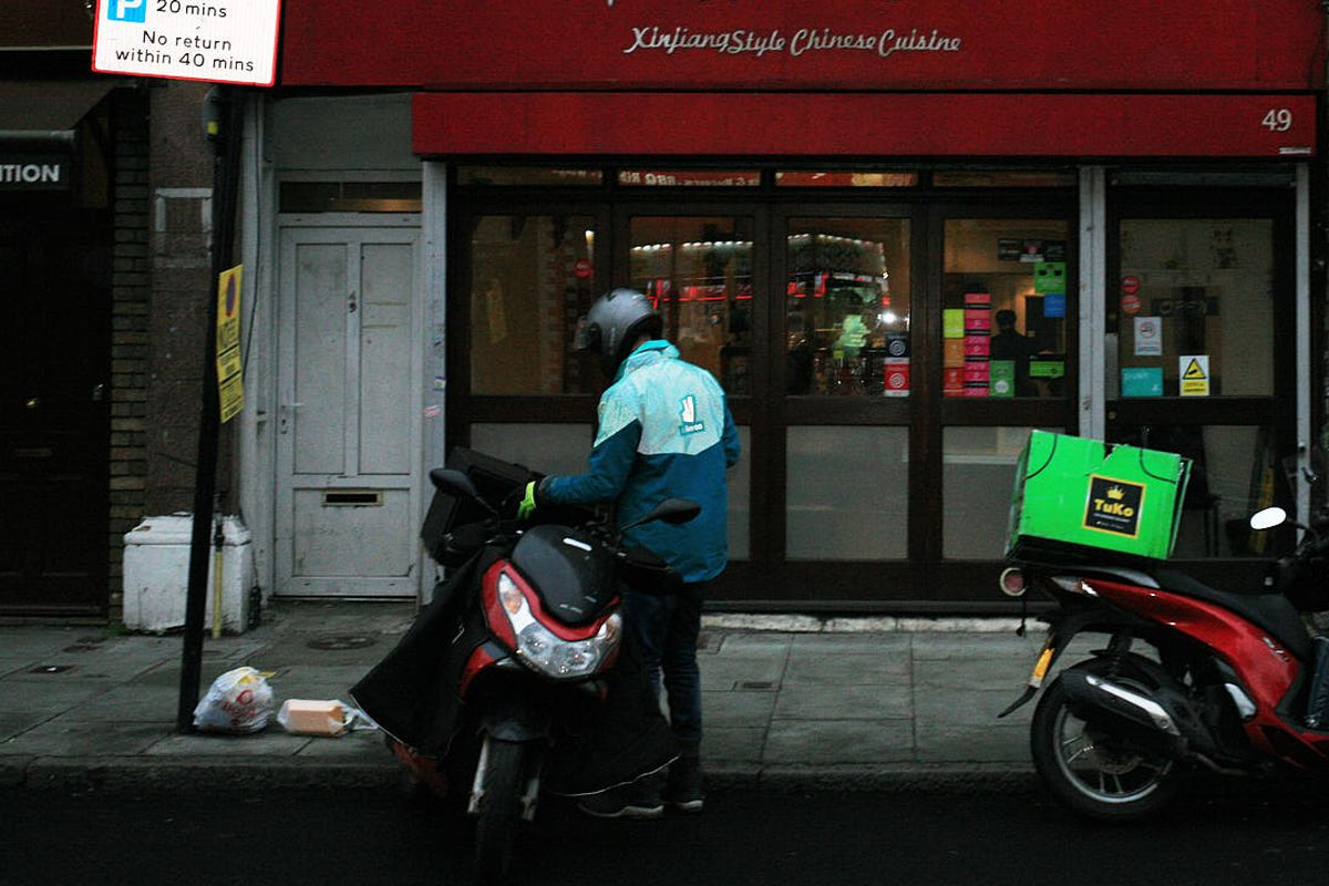 A Deliveroo rider in London waits for a collection in Camberwell, while London is under coronavirus lockdown restrictions. March 2021
