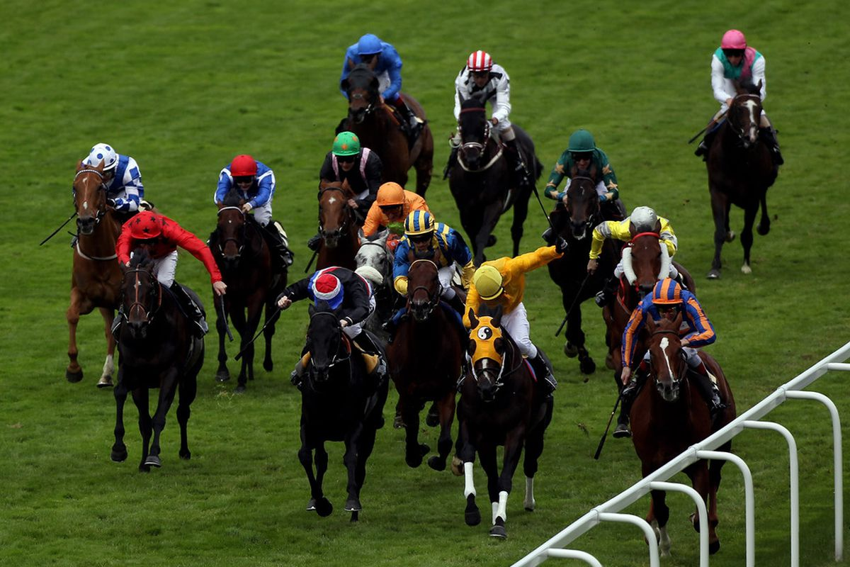 ASCOT, ENGLAND - JUNE 19: Johnny Murtagh and Starspangledbanner (striped capon rails) land The Golden Jubilee Stakes run on the 5th day of Royal Ascot at Ascot Racecourse on June 19, 2010 in Ascot, England. (Photo by Julian Herbert/Getty Images)