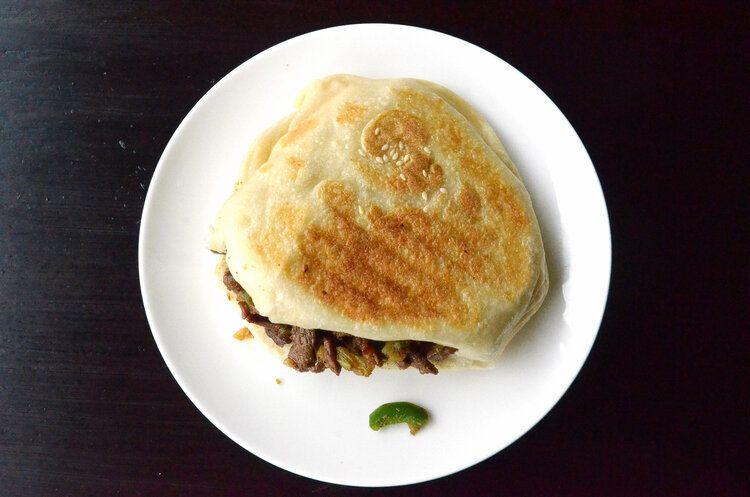 A flatbread sandwich on a plate.