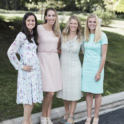 Chalise Southwick stands with her friends, who are modeling a few of the dresses currently featured in her inaugural dress line.