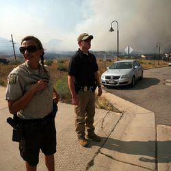 Park Ranger Dawn Larsen and State Parks Deputy Cory Meeks evacuate residents from the Lodge at Stillwater as a wild fire burns near the Jordanelle Reservoir on Saturday, Aug. 18, 2012.