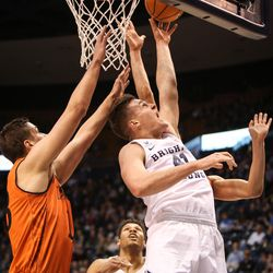 Brigham Young Cougars forward Luke Worthington (41) shoots up and under Idaho State Bengals center Novak Topalovic (13) as BYU takes on Idaho State at the Marriott Center in Provo on Thursday, Dec. 21, 2017.