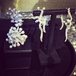 """These stunning earrings were inspired by a """"white swan taking flight in a flurry of feathers."""""""