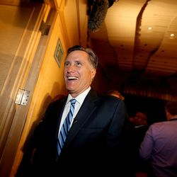 Former governor of Massachusetts Mitt Romney exits the auditorium after addressing the Hinckley Institute of Politics at the University of Utah on the state of the 2016 presidential race in Salt Lake City on Thursday, March 3,  2016.