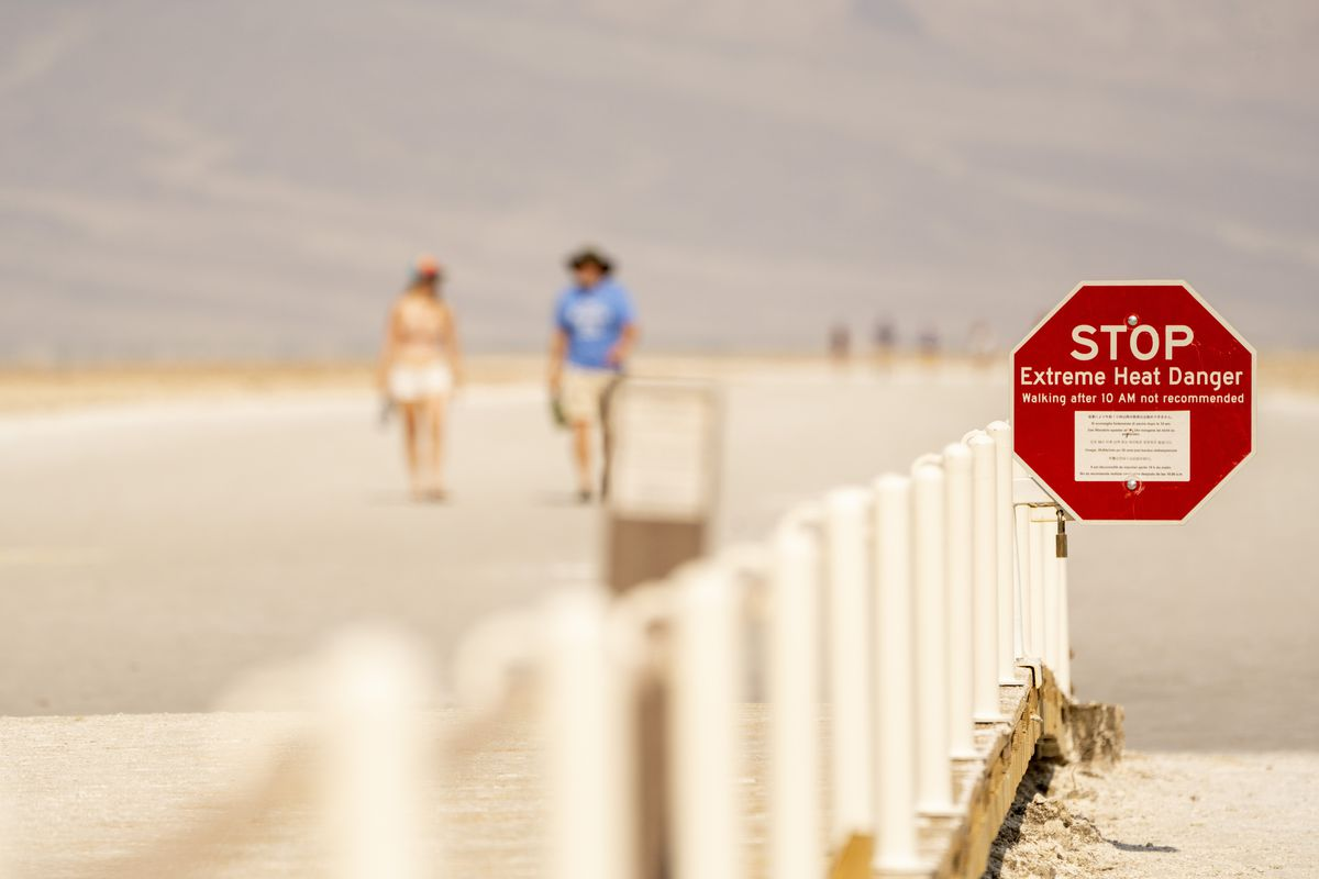"""An """"Extreme Heat Danger"""" sign at the Badwater Basin in Death Valley, California, U.S., on Thursday, June 17, 2021."""