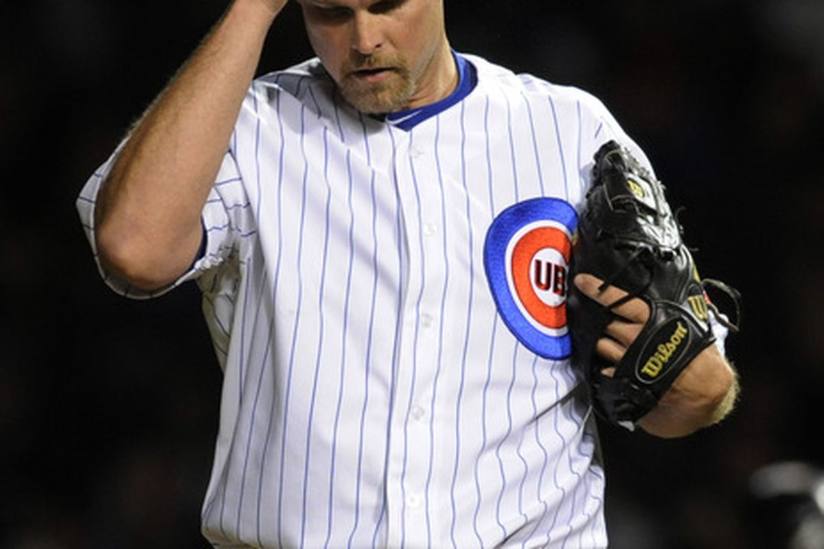 CHICAGO, IL - MAY 08: Kerry Wood #34 of the Chicago Cubs reacts after giving up two runs to the Atlanta Braves in the eighth inning  on May 8, 2012 at Wrigley Field in Chicago, Illinois.  (Photo by David Banks/Getty Images)