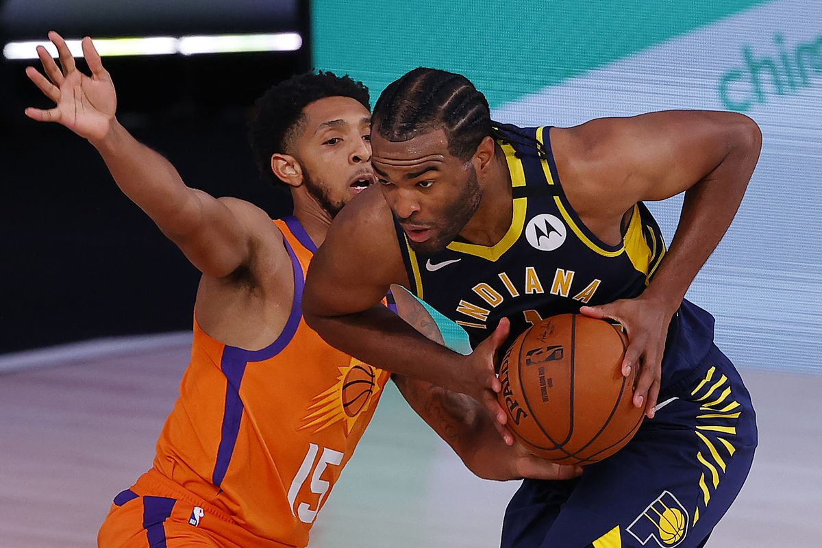 T.J. Warren of the Indiana Pacers drives against Cameron Payne of the Phoenix Suns at Visa Athletic Center at ESPN Wide World Of Sports Complex on August 06, 2020 in Lake Buena Vista, Florida.