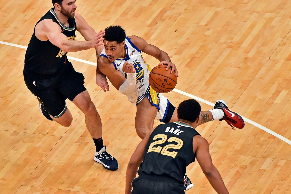 Jordan Poole of the Golden State Warriors goes to the basket against John Konchar of the Memphis Grizzlies during the second half at FedExForum on March 19, 2021 in Memphis, Tennessee.