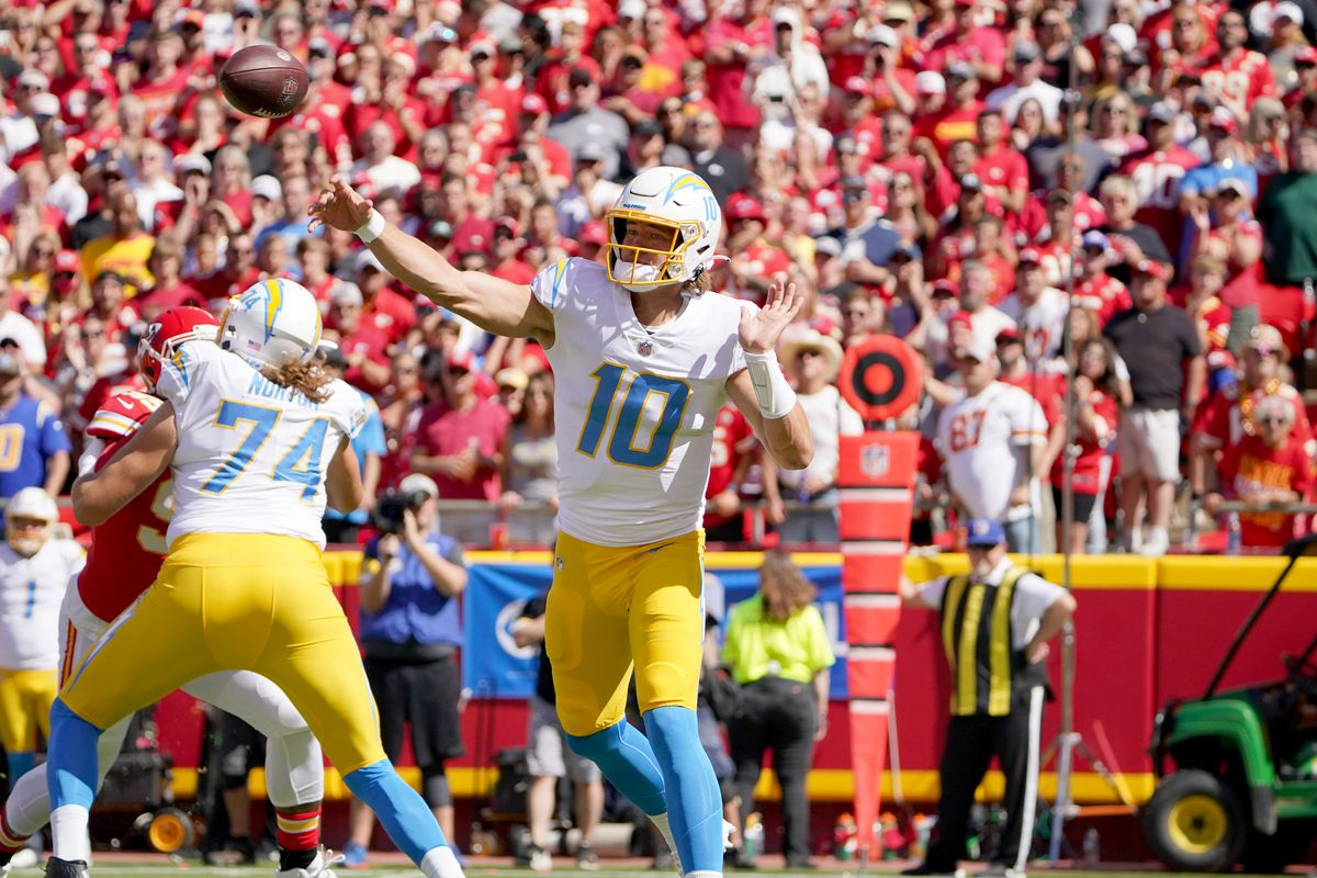Los Angeles Chargers quarterback Justin Herbert (10) throws a pass against the Kansas City Chiefs during the first half at GEHA Field at Arrowhead Stadium.