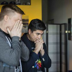 Matt Schreck, 43, and his husband, Fernando Gutierrez, 41, get emotional as they watch the inauguration ceremony for President Joe Biden and Vice President Kamala Harris from their South Loop home, Wednesday morning, Jan. 20, 2021.