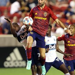 Real Salt Lake forward Justin Meram (9) controls the ball as he and Vancouver Whitecaps forward Deiber Caicedo (7) crash into each other as Real Salt Lake and Vancouver FC play at Rio Tinto Stadium in Sandy on Wednesday, July 7, 2021. RSL won 4-0.