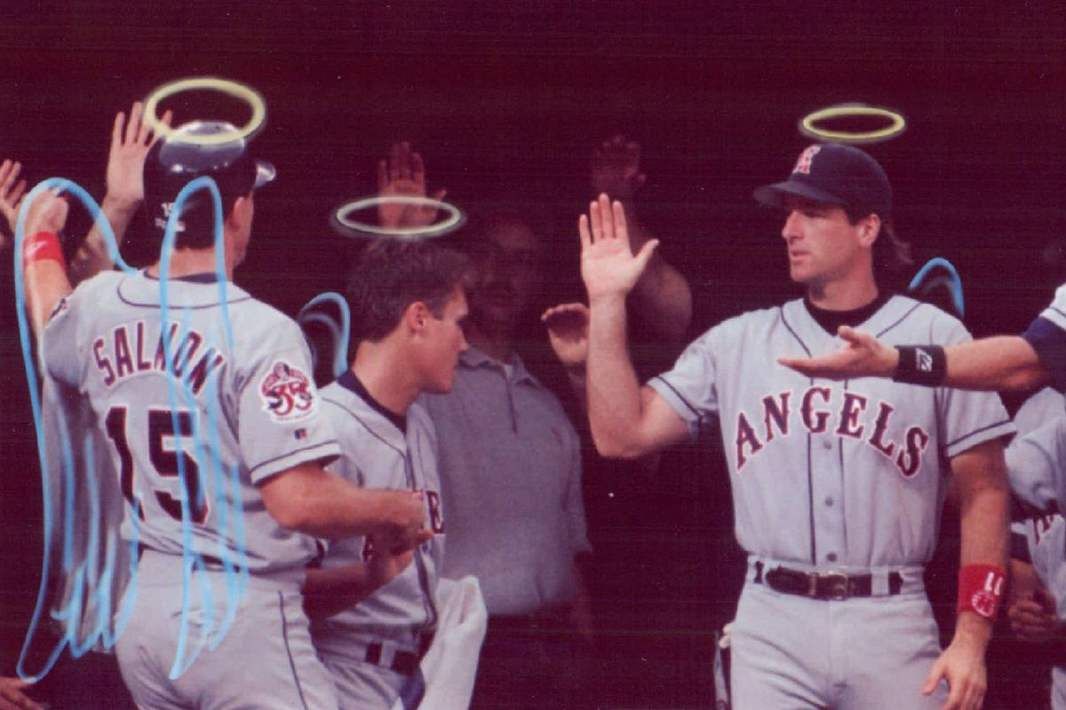 Angels outfielders with halos and wings drawn on