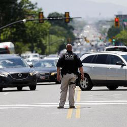 Officers direct traffic as protesters rally against a Senate GOP health care bill block in Salt Lake City on Tuesday, June 27, 2017.