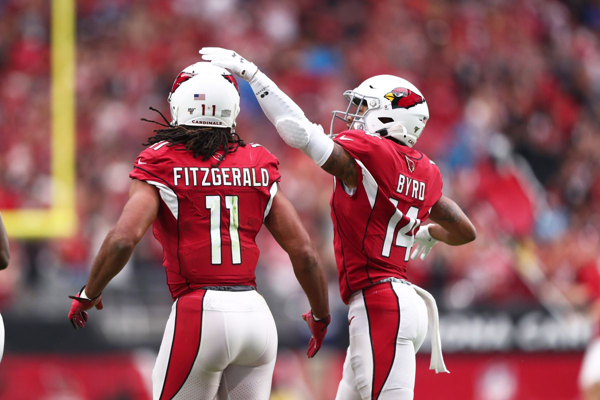 Arizona Cardinals wide receiver Larry Fitzgerald is congratulated by teammate Damiere Byrd after scoring a first quarter touchdown against the Carolina Panthers at State Farm Stadium.