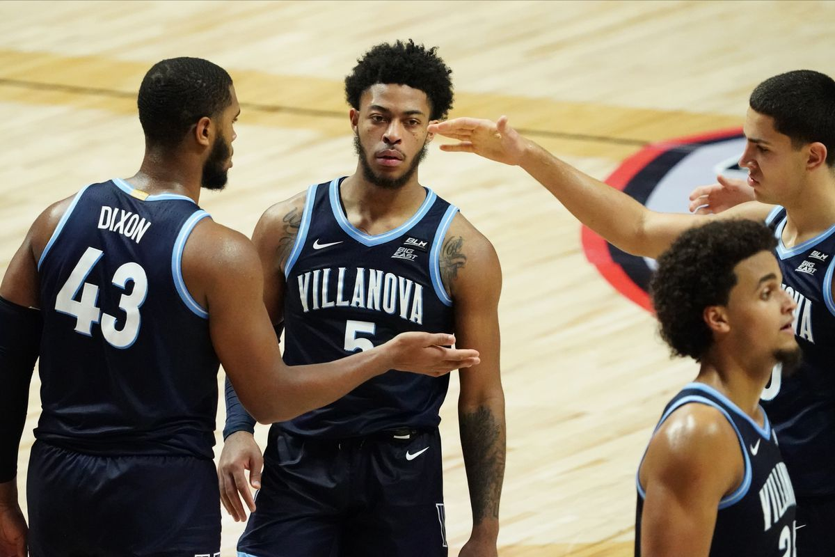 Villanova Wildcats forward Cole Swider, forward Eric Dixon and guard Justin Moore react after a play against the Hartford Hawks in the second half at Mohegan Sun Arena.