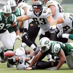 """<strong>2002</strong> """"Jacksonville Jaguars' quarterback Byron Leftwich (7) fumbles the ball as he's sacked by New York Jets' John Abraham (56) in the third quarter at Giants Stadium. The Jets' James Reed (93) recovered and ran 33 yards for a touchdown. Jacksonville went on to win, 26-20, in overtime."""""""