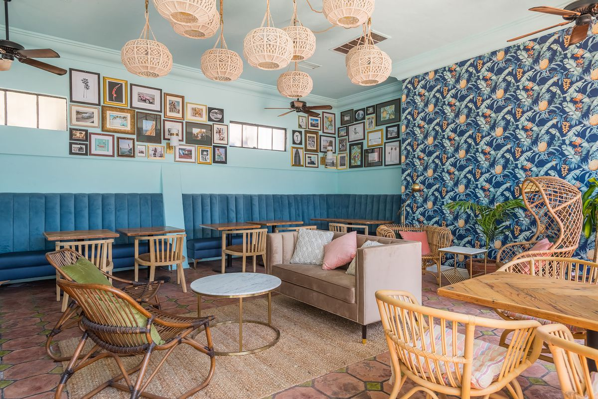 Colorful bar wallpaper and blue tones inside of a beach bar.