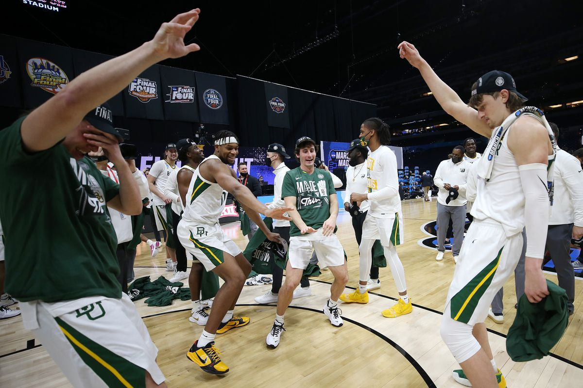 The Baylor Bears celebrate after defeating the Arkansas Razorbacks in the Elite Eight round of the 2021 NCAA Men's Basketball Tournament at Lucas Oil Stadium on March 29, 2021 in Indianapolis, Indiana.