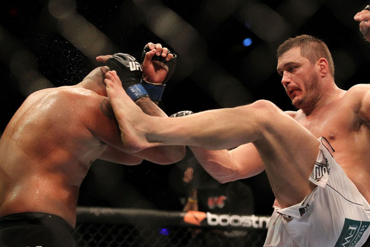 INDIANAPOLIS - SEPTEMBER 25:  (R-L) Matt Mitrione kicks Joey Beltran during their UFC heavyweight bout at Conseco Fieldhouse on September 25 2010 in Indianapolis Indiana.  (Photo by Al Bello/Zuffa LLC via Getty Images)