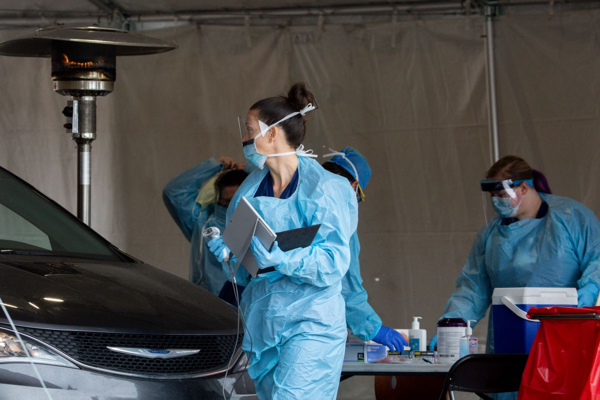 Health care workers operate a COVID-19 drive-thru testing site at Timpanogos Regional Hospital in Orem on Monday, April 6, 2020.