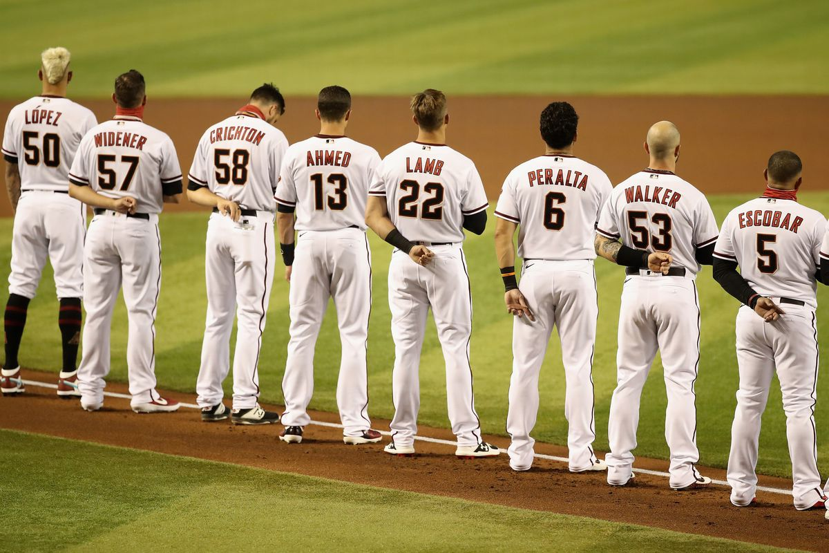 The Diamondbacks line up for the National Anthem in an empty stadium with absolutely zero social distancing