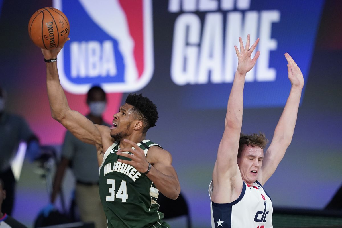 Giannis Antetokounmpo of the Milwaukee Bucks drives to the basket against Anzejs Pasecniks of the Washington Wizards during the first half at Visa Athletic Center at ESPN Wide World Of Sports Complex on August 11, 2020 in Lake Buena Vista, Florida.