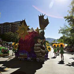 The Salt Lake Monument Park North Stake of the Church of Jesus Christ of Latter-day Saints float passes a stalled float with engine trouble as spectators watch the floats, horses and celebrities participate in the Days of '47 Parade in Salt Lake City Saturday.