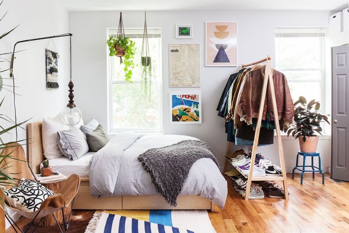 351e0fa935 This 600-square-foot Philly apartment takes advantage of a storage bed for  hidden items and a custom A-frame rack for showing off favorite garments.