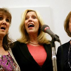 LeeAndra Lowe, Cherilyn Eagar and Nancy Schultz sing a song during a memorial service for Janie Thompson, the founder of BYU's internationally touring Young Ambassadors, at the BYU multi-stake center in Provo on Saturday, June 8, 2013.
