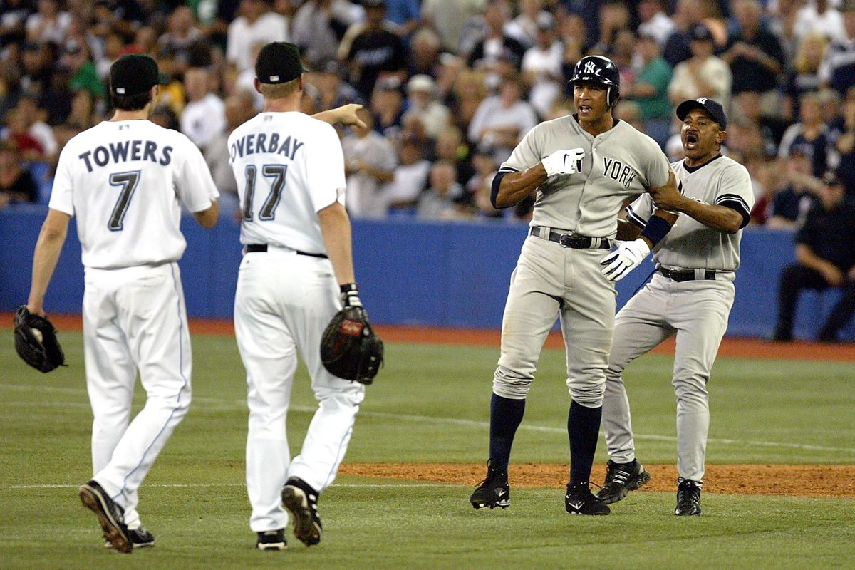 Josh Towers and Lyle Overbay of the Blue Jays have an on-field interaction with the Yankees' Alex Rodriguez.